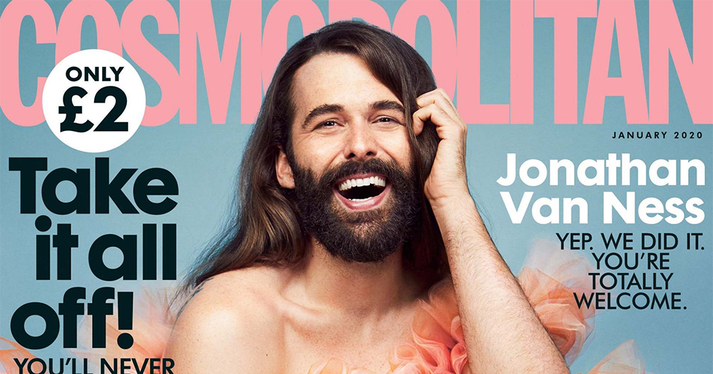 The cover of Cosmopolitan magazine featuring a man with a beard and long hair smiling wearing a frilly dress