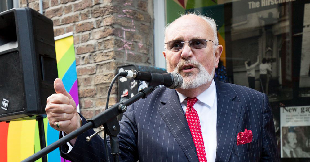 David Norris speaking into a microphone at a launch