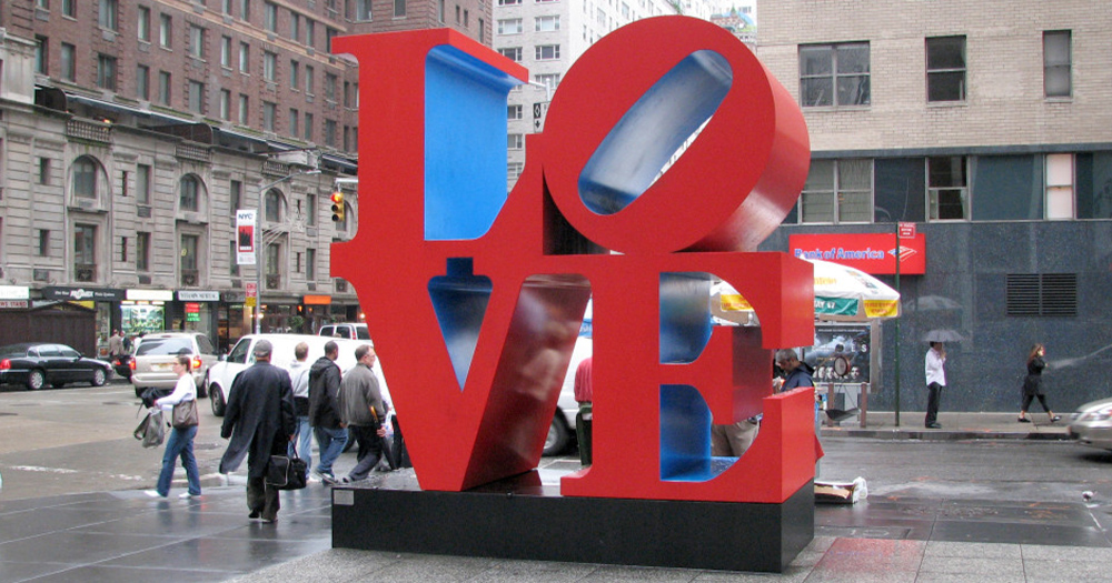 A Pop art sculpture on the street spelling out the word love in hug plastic stacked letters
