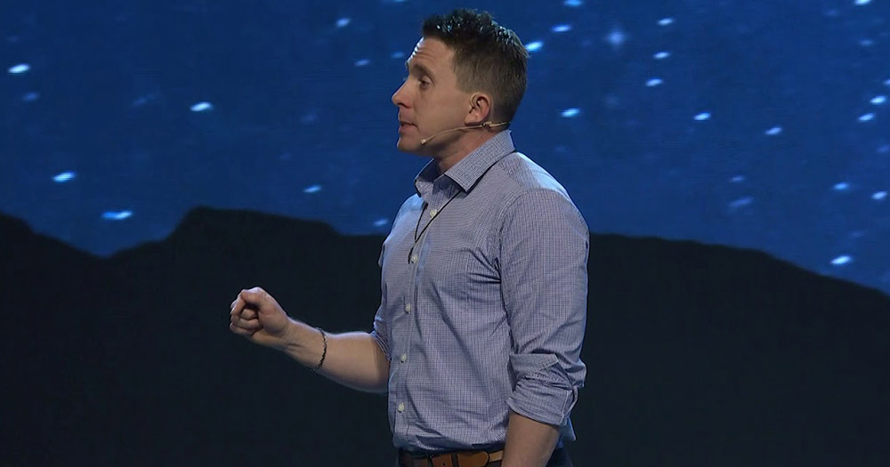 Chastity speaker Jason Evert walking to the side against a starry night in one of his talks