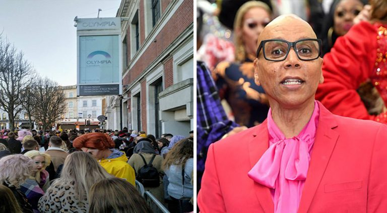 RuPaul standing above DragCon UK pointing down at the crowd