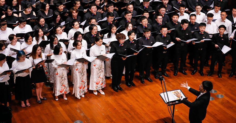 Beijing Queer Chorus singing in a concert, one of the LGBT+ choirs singing against hate across Asia.
