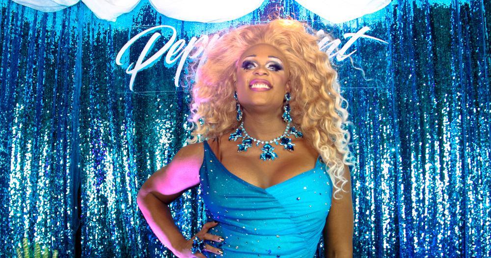 Peppermint, standing in a blue dress, will be one of six black drag race queens in the show.