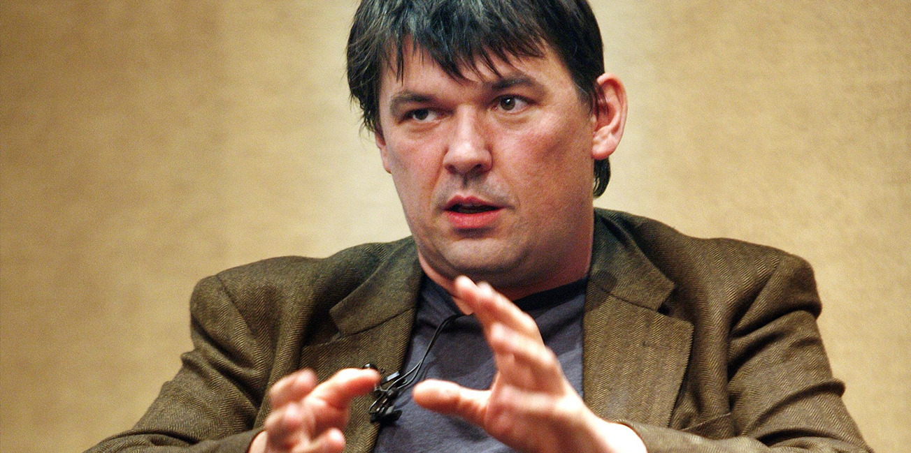 Graham Linehan with his hands up and looking confused