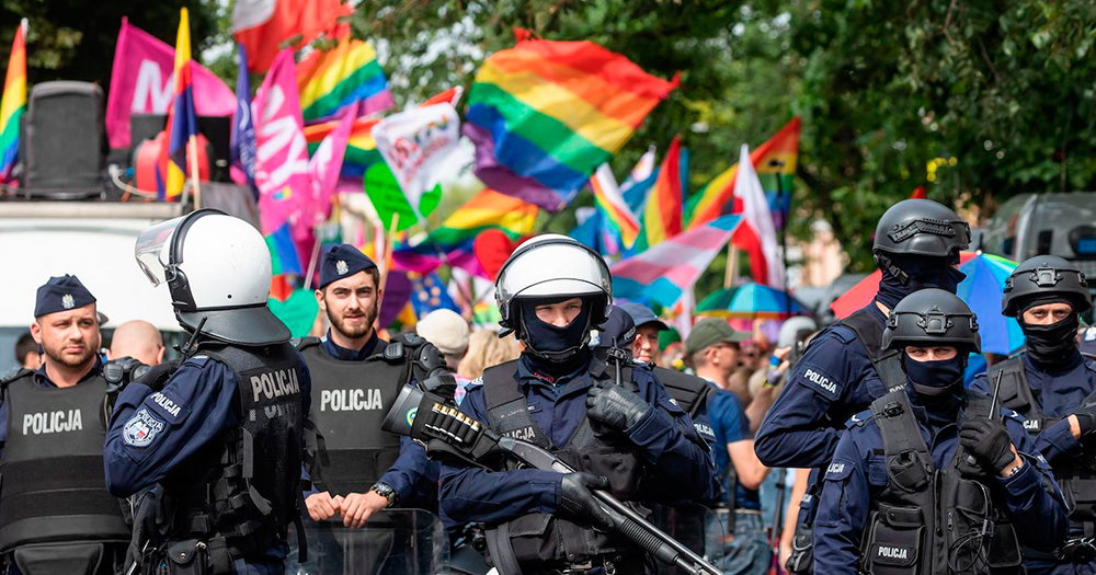 Armed police walking ahead of a Polish Pride parade, it was undercover police which found the explosives made by the married couple