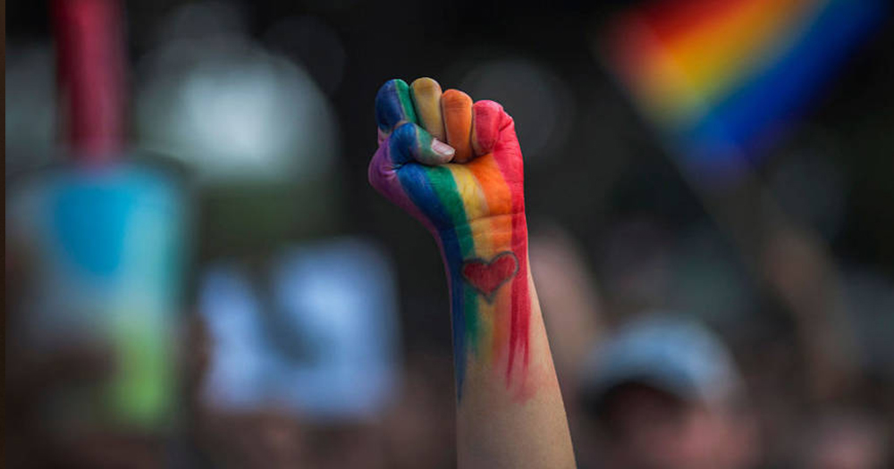 A fist raised in the air, painted in rainbow colours and a love heart on the wrist, survivors of 'conversion therapy' are creating changes towards outlawing the practice, new report finds
