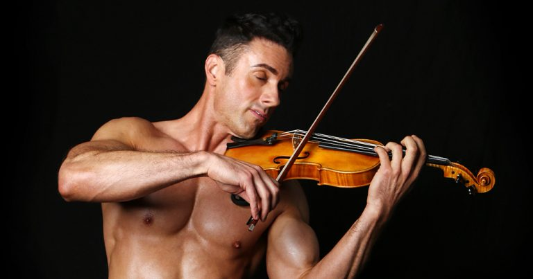 The Shirtless Violinist - a topless muscle bound man - plays a violin