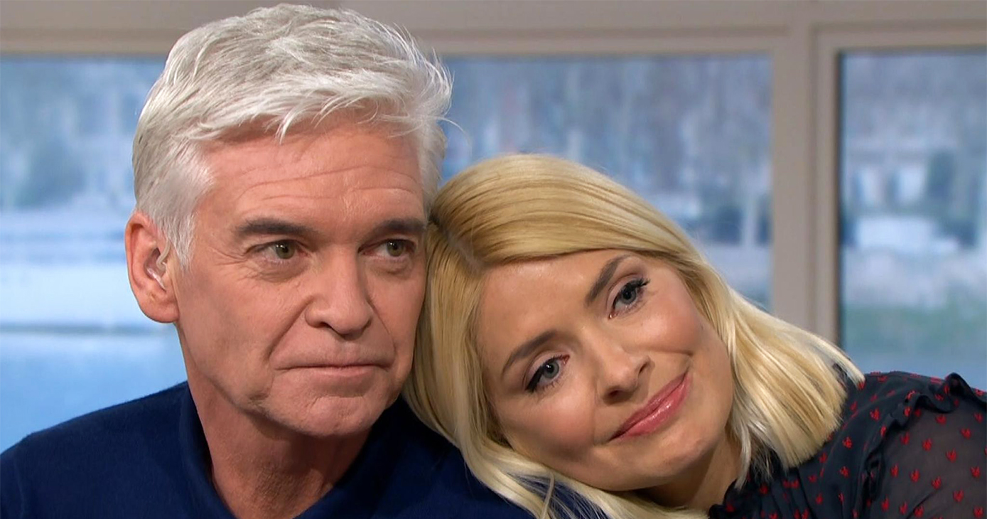 Close up of Phillip Schofield and Holly Willoughby. Holly is resting her head of Philip's shoulder