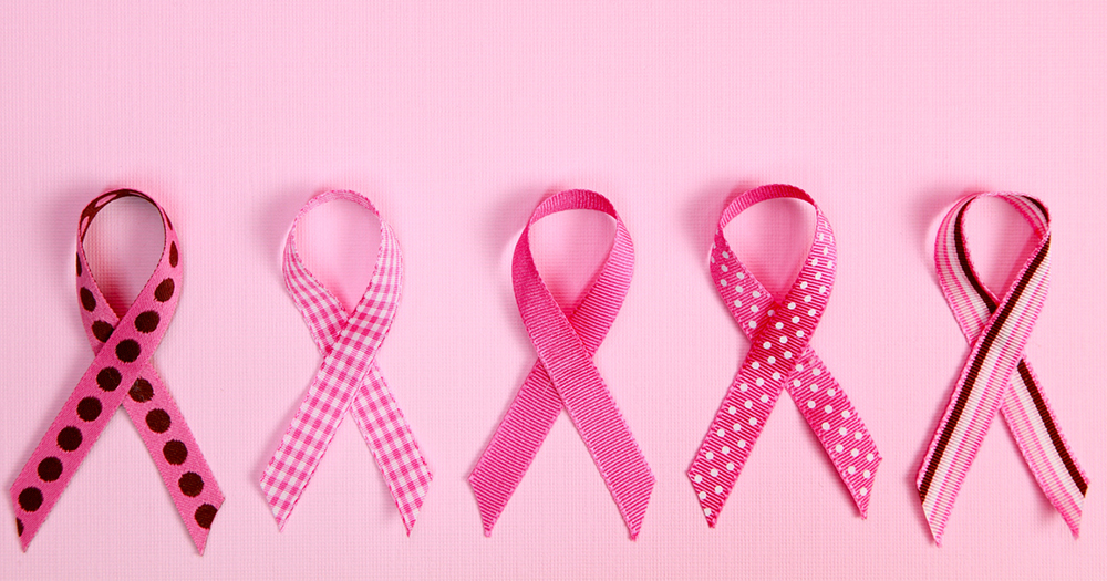 Five pink ribbons on a pink background
