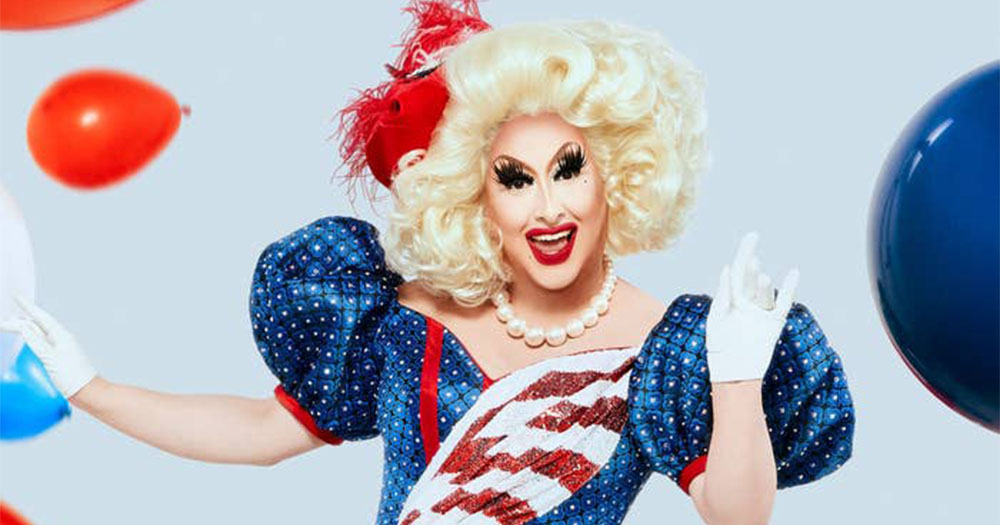 Drag Race star Sherry Pie poses in full drag surrounded by falling balloons