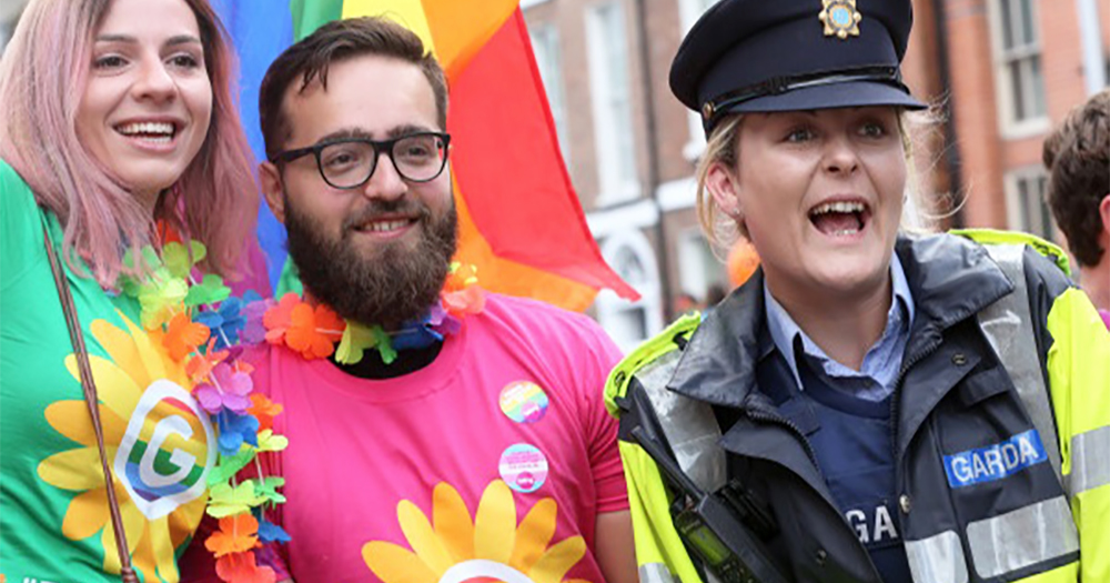 A member of the Garda smiling with a man and a woman at Pride. Granard hosted its fist Garda LGBT+ event