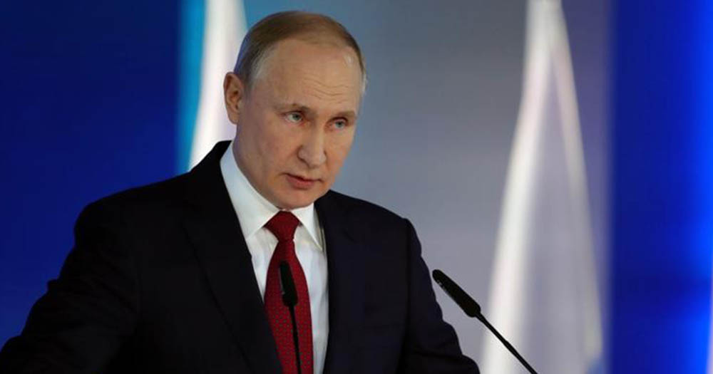 Putin standing at a podium with a blue background, he seeks to change constitution to define marriage as between a man and woman.