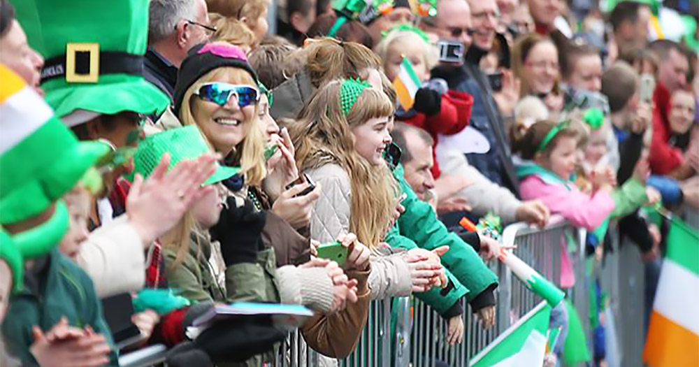 St Patrick's Day parades onlookers all dressed in green and decked out with the tricolour