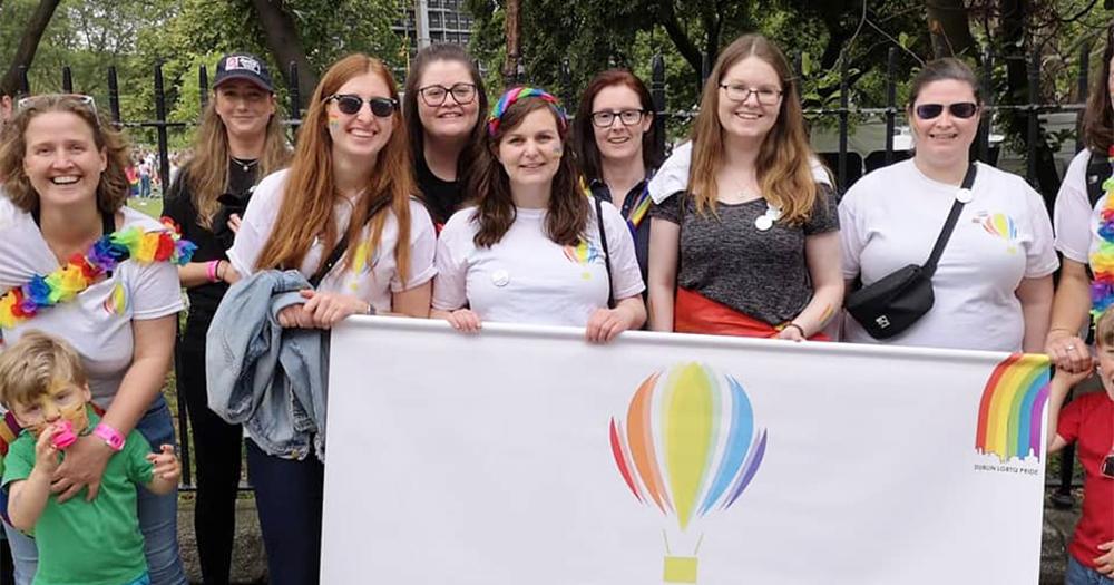 A group of women holding a banner for Dublin Lesbian Line