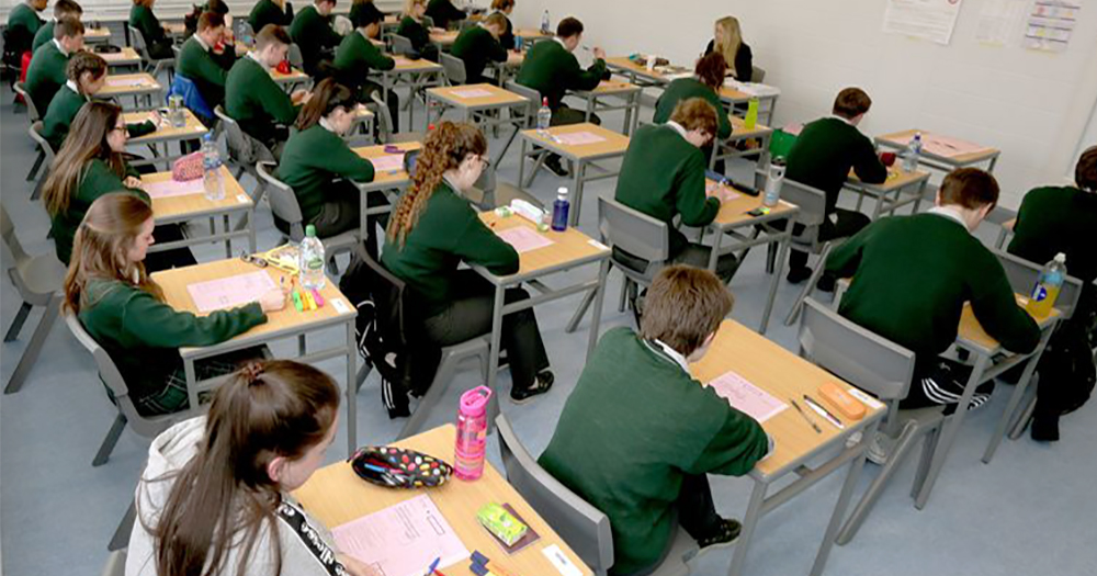 Several student in a classroom attending their leaving cert