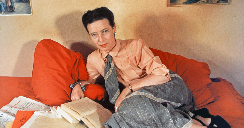 Simone de Beauvoir lying on a bed with a novel, her previously unpublished book will finally be released later this year