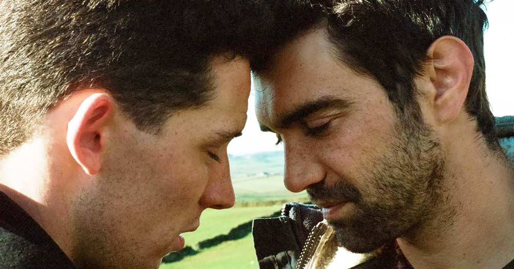 Sex scenes from God's Own Country have recently been cut from film distributors- 2 men about to kiss.