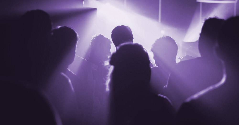 LGBT+ nightlife - people dancing in a nightclub