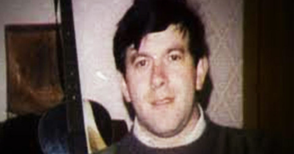 An old photo of Declan Flynn - a dark haired man with a slight smile