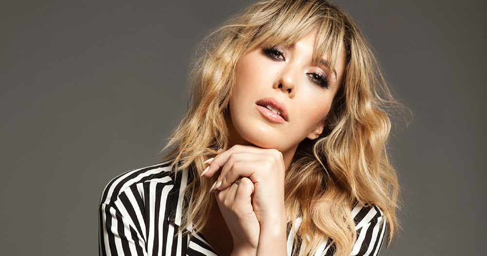 Paris Lees in a striped black and white shirt.