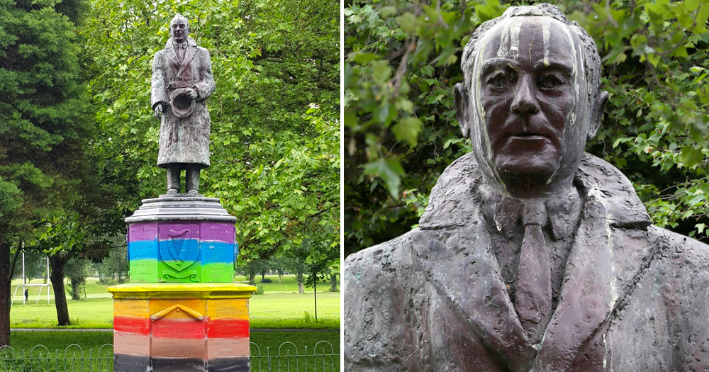 Statue of Sean Russell in a park, the base painted in rainbow colours