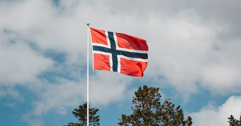 The flag of Norway against the sky