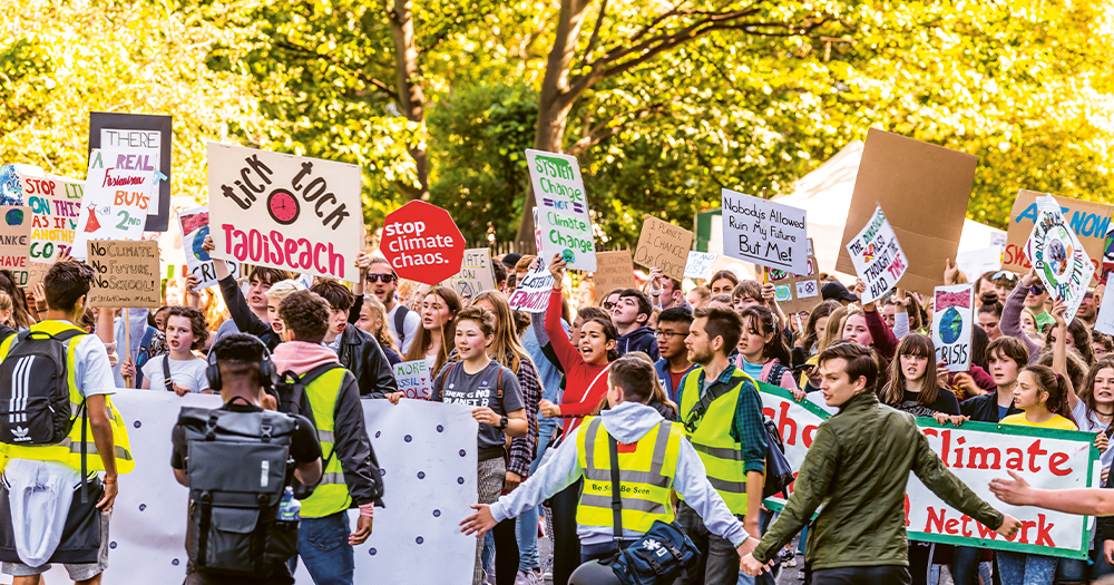 A climate strike with crowds of young people holding banners