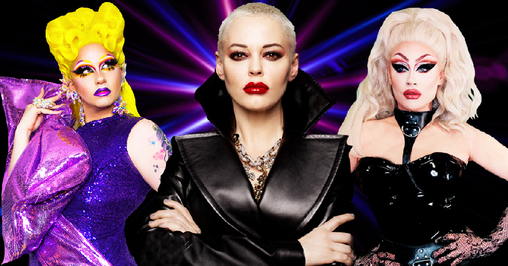 A woman with shaved hair is flanked by two drag queens
