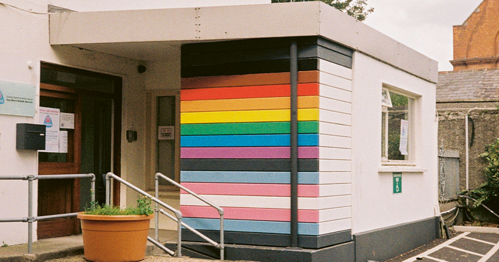 The exterior of a building with a rainbow flag painted on its side
