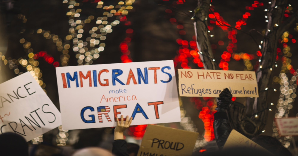 Protesters supporting LGBTQ+ immigrants DACA: hold up signs, declaring 'immigrants make America great'