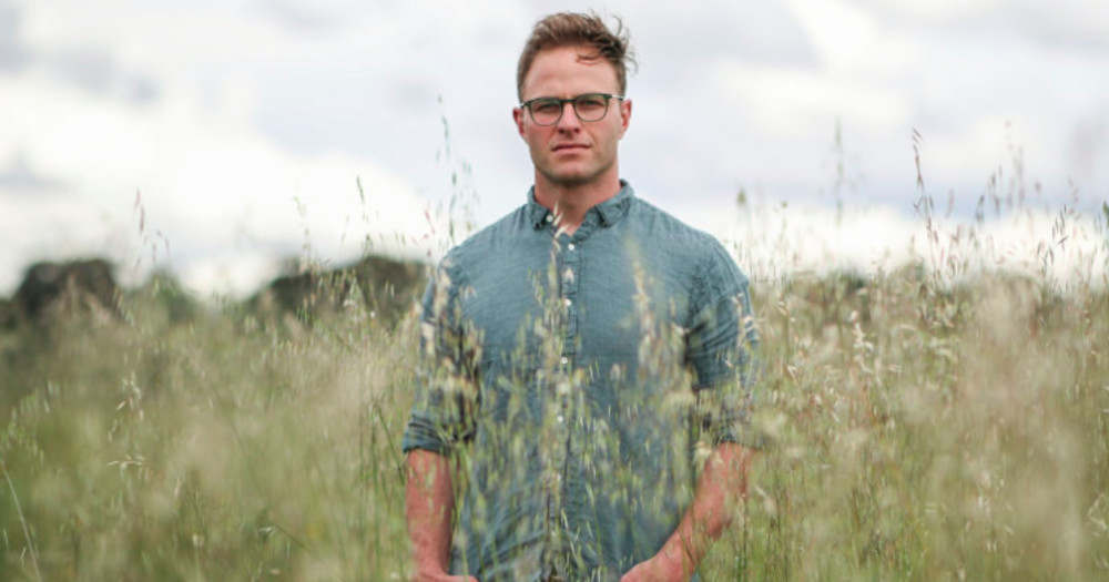 Former Aussie rugby player comes out as gay, Dan Palmer stands in a field.