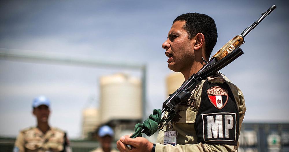 An Egyptian policeman with a gun over his shoulder