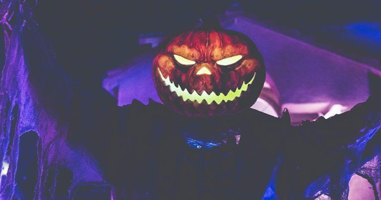 A pumpkin with a light up monster face