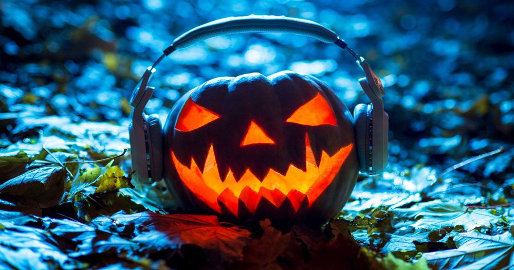Spooky Irish podcasts: a pumpkin lantern wearing headphones