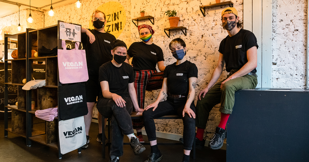 Staff from Vegan Sandwich Co wearing masks posing for a photo