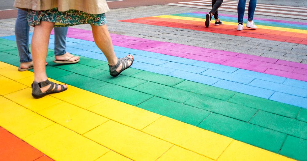 West Cork rainbow crossing a person walks accross a rainbow crossing