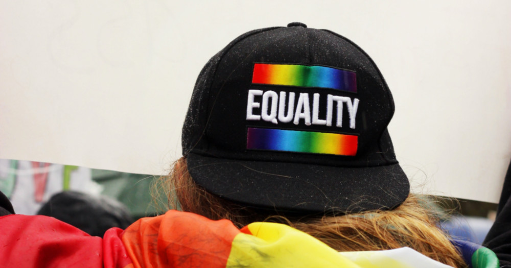 black hat with the words 'equality' in rainbow, bill banning lgbtq+ parades