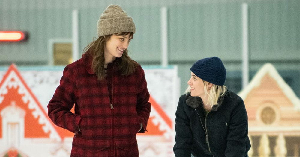 Abby and Harper looking at each other while ice skating, Christmas movie Happiest Season