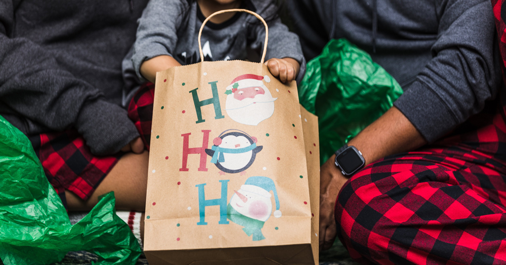 LGBTQ+ families: picture of a Christmas bag surrounded by an LGBTQ+ families