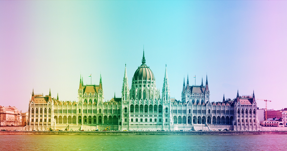 Hungary LGBTQ amendments Hungarian parliament building with overlay of rainbow gradient