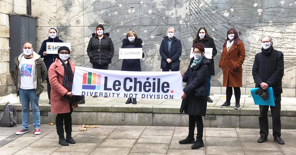 "Members of Le Chéile alliance holding a banner that reads ""diversity not division"""
