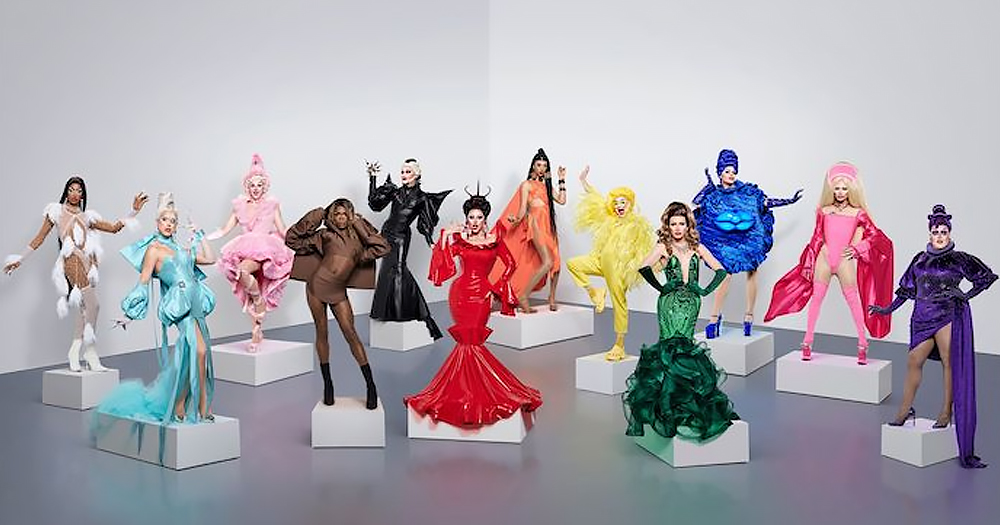 Promotional image for Drag Race UK season 2, showing all twelve queens wearing solid colour to make up a rainbow