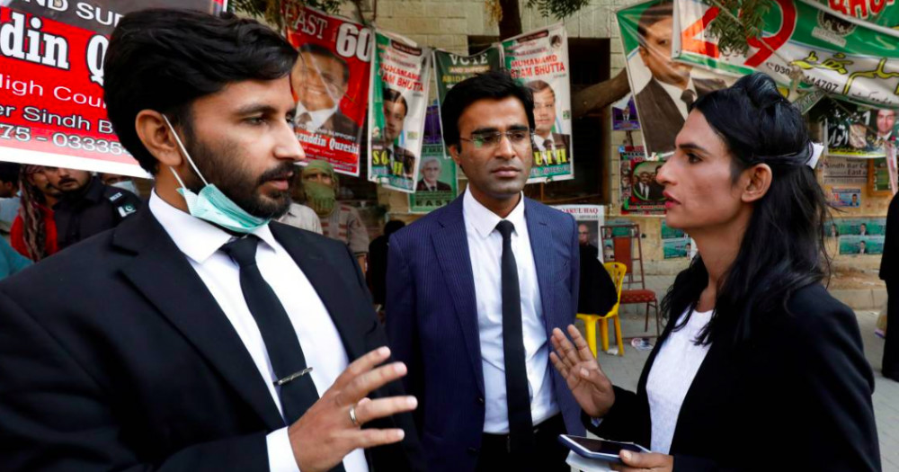 Nisha Rao speaks with her colleagues as Pakistan's first trans lawyer