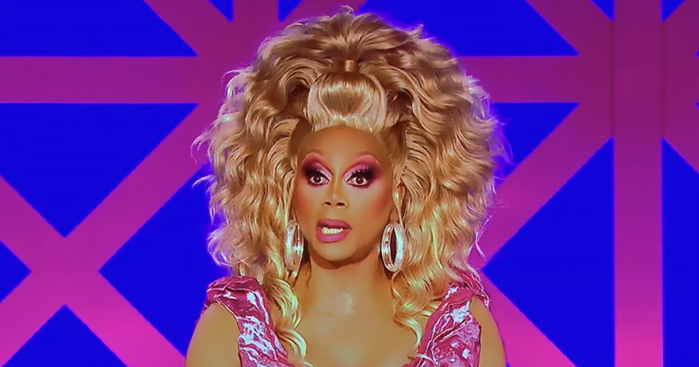 RuPaul wearing a blonde wig and pink dress during the latest episode of Drag Race UK where she flew into fit of rage over H&M dress