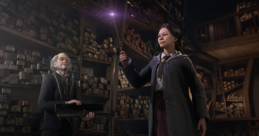A still from the Hogwarts Legacy game showing a student holding up a wand surrounded by scrolls, the game will now include trans characters