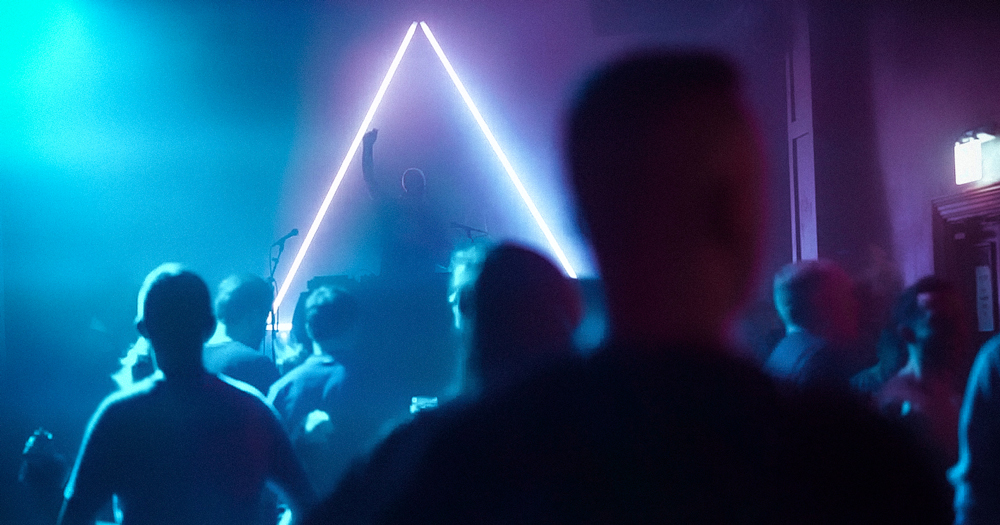 Screenshot from Mother documentary about queer spaces,showing the Mother triangle and people on a dancefloor