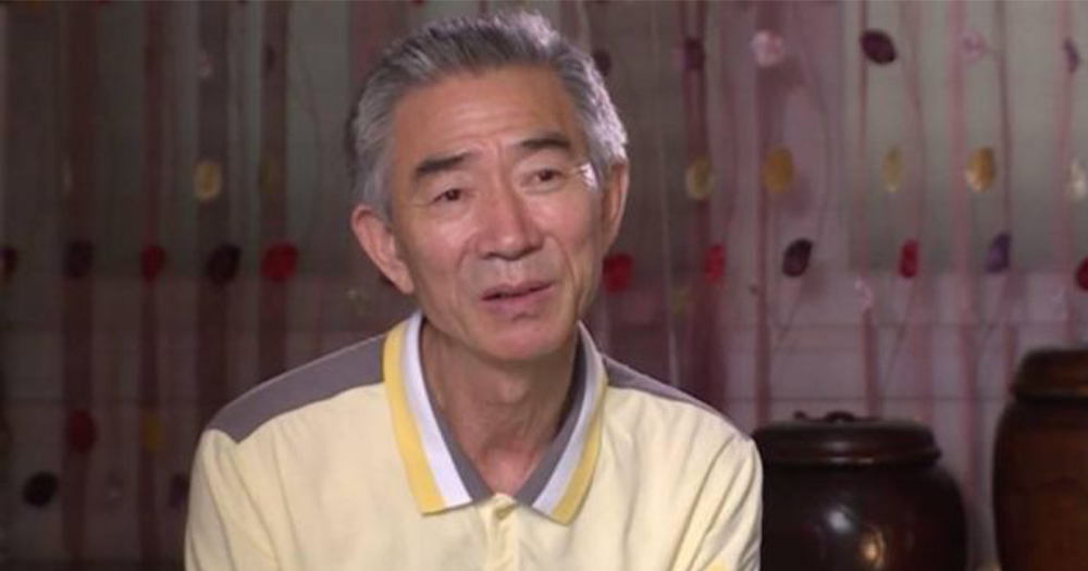 An older Korean man speaking