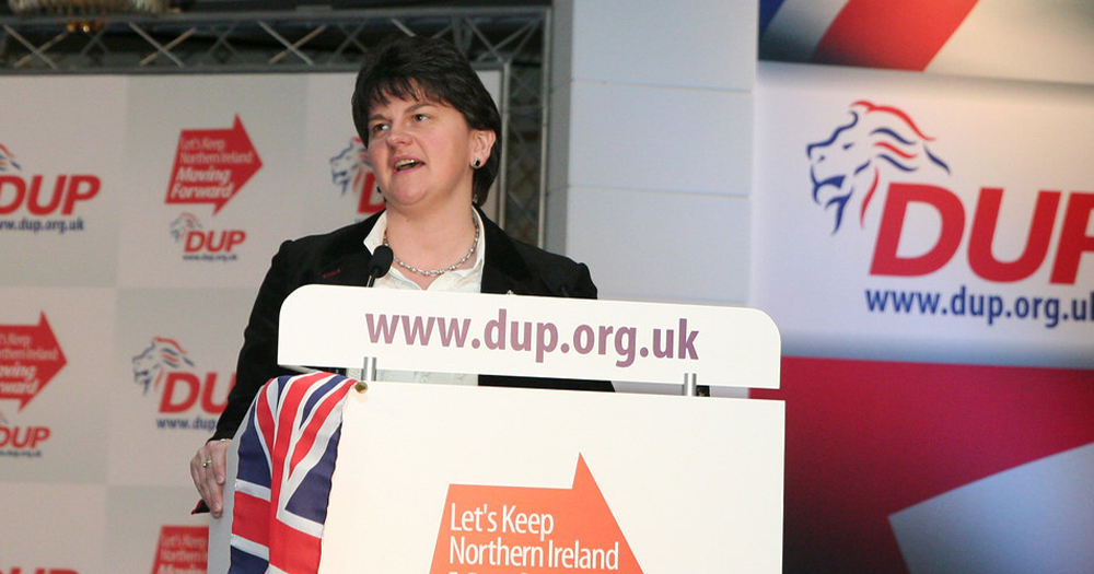A female politician standing behind a podium