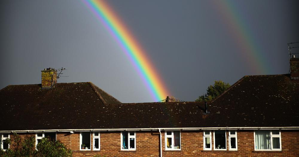 A rainbow over a house