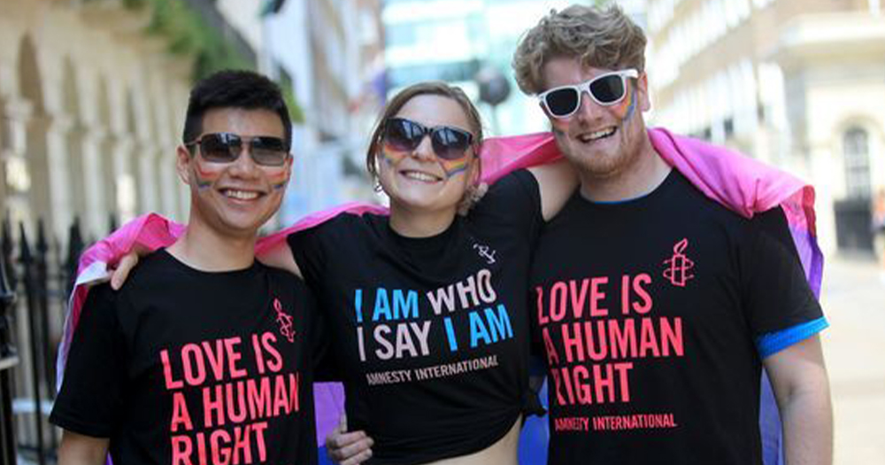 two men and a woman wearing pro LGBTQ+ jumpers